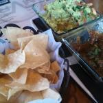 Delicious guacamole, salsa, chips, and mojito!