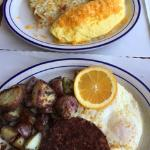 Omelet plate, corned beef hash and eggs plate