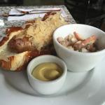 Bratwurst, sauerkraut, pretzel roll, German mustard and potato salad (lunch portion)