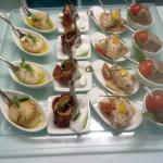 scallop with curried mango, fig and parma ham, torn mozarella, salmon rilettes canapes