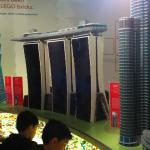 A few models from the Lego exhibit with the Lego for playing underneath.