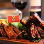 THE TRADITIONAL SAMPLER: The sampler plate of BBQ ribs, pork neck, beef and chicken wings.