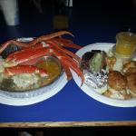Crab legs, baked potato and stuffed shrimp