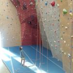 Tommy studying the routes on this 55 foot wall