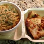 Spinach-Tomato Orzo with pieces of toasted pita bread