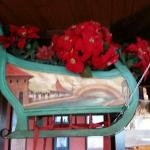 Sleigh hanging in restaurant/