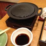 Wagyu steak. To be cooked at table on cast iron portable stove provided by charming kimono-clad