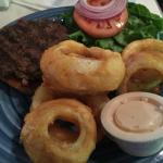 Hand pattied hamburger and onion rings