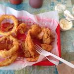 Half eaten seafood dinner with the most amazing onion rings ever! My wife has a shrimp po boy an