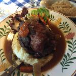 Pork Shank over Mashed Potatoes and Fresh Vegetables