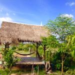 Traditional Khmer hut with hsmmocks for the guests to relaxing and reading books with a calm and (133476826)