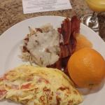 yummy breakfast, made to order omelettes and hashbrowns and gravy bacon fresh fruit.