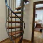 The spiral staircase to the upper room