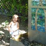 My daughter enjoying the art that is scattered among the nature