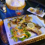 Grilled fish with roasted potato and salad