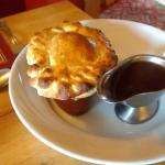 One of a selection of Their Home made pies ( part is hand made on ordering )