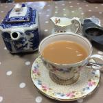 Lovely china tea cups and leaf tea.