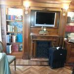 Fireplace, TV and bookshelves