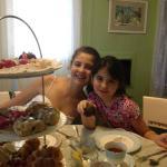 Girls enjoying wonderful tea goodies.
