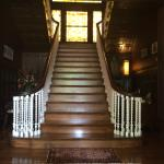 Main staircase w/stained glass window