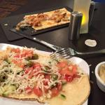 Mediteranian Tostada in front, Chicken and Spinach flatbread in back..