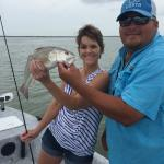 Capt. Machost and my wife with an awesome red fish.