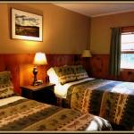 The River Bend room with two double beds, private bath and kitchenette