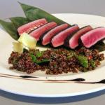 Our Signature Tuna Loin Dish, served with organic quinoa and lemonsalad