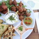 Bollywood platter with samosas, spicy wings, pakoras, naan bread and spicy wings