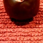An elegant blood orange truffle.
