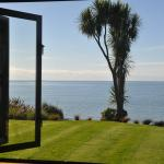 View of the sea from a Beachfront Cottage bedroom - all rooms at Adrift have beds facing out to