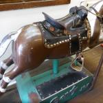well-used mechanical horse