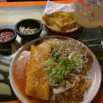 Steak burrito extraordinare, that is a jumbo margarita for perspective. Come hungry and take hom
