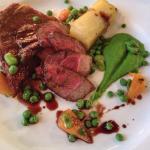 £15.5 Lamb rump & breast, confit potatoes, pea purée, spring vegetables, lamb jus