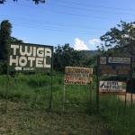 Twigs hotel sign, grounds and the nearby mountains.