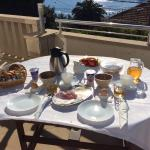 rich breakfast on the apartment's terrace