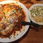 Veal Pizziola with cheese. Side of spaghetti with oil & garlic
