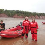 Standing on a sand bar in the middle of the Shubenacadie River, waiting for the tide