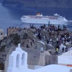 One of the cruiseships , passing the old casle with tourists