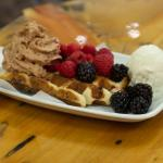 Liege waffle with berries, Nutella whipped cream & vanilla ice cream.
