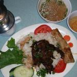 #53 with rice (instead of vermicelli) served with egg rolls, dipping sauce & broth