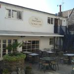 Lovely sun trap in the outside courtyard, many tables available.