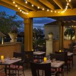 Dine outside on the WaterScapes patio overlooking the pool and marina