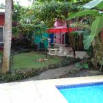 Jaco Lodge outside patio near the pool