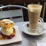 outside enjoying a scone and a latte :D