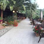Relaxing patio for breakfast or wine in the afternoon overlooking vineyard, town, and area to pl
