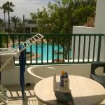 balcony overlooking pool area - one bed apartment