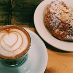 Cortado with almond milk and an almond croissant