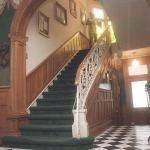 Our entry complete with grand staircase and black& white tile floor
