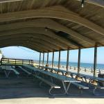 Pavilion for rent- many large tables, a stage, outlets, and cover